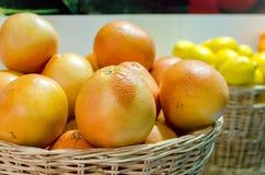 Wicker basket full of oranges Royalty Free Stock Photo