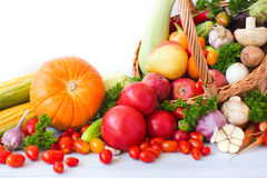 Wicker basket full of organic fruit and vegetables. Stock Image