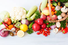 Wicker basket full of organic fruit and vegetables. Healthy eating Stock Photos