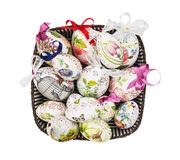 Wicker basket full of painted Easter eggs Stock Photo