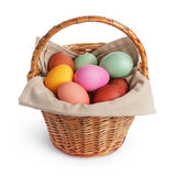 Wicker basket full of pastel colors easter eggs Stock Image