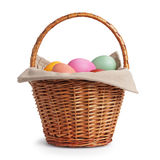 Wicker basket full of pastel colors easter eggs Stock Photography