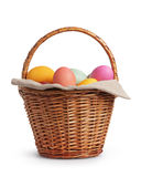 Wicker basket full of pastel colors easter eggs Royalty Free Stock Photo