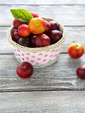 Wicker basket full of ripe plums Royalty Free Stock Images