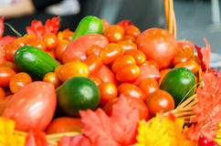 Wicker basket full of tomatoes and cucumbers Stock Photography