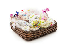 Wicker basket full of various Easter eggs Royalty Free Stock Photos