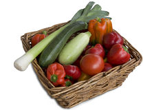 Wicker basket full of vegetables. Wicker basket full of fresh, colorful and tasty vegetables Stock Images