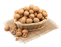 Wicker basket full of walnuts Royalty Free Stock Photography