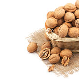 Wicker basket full of walnuts Royalty Free Stock Photo