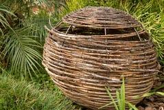 Wicker basket in a garden Stock Photos