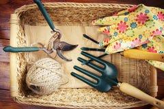 Wicker basket with garden tools Stock Photo
