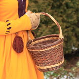 Wicker basket in girls hands Stock Images