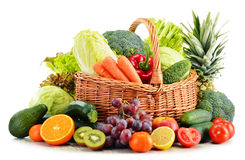 Wicker basket with groceries on white Royalty Free Stock Images