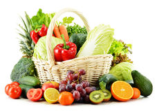 Wicker basket with groceries on white Stock Photo