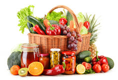 Wicker basket with groceries on white Royalty Free Stock Photo