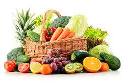 Wicker basket with groceries on white Stock Photos