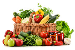 Wicker basket with groceries on white Stock Images