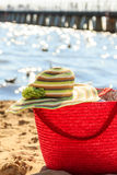 Wicker basket handbag bag and hat on summer beach. Royalty Free Stock Photos
