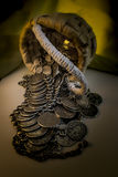 Wicker Basket With Handle And Spilled Coin Jewelry Royalty Free Stock Photos