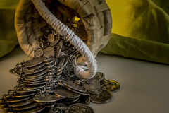 Wicker Basket With Handle And Spilled Coin Jewelry Royalty Free Stock Image