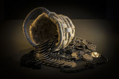 Wicker Basket With Handle And Spilled Coin Jewelry Royalty Free Stock Images