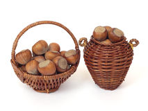 Wicker basket with hazelnuts Royalty Free Stock Photo