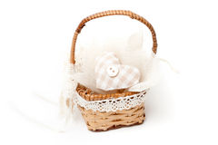 Wicker basket with  heart and button Royalty Free Stock Photo