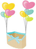 Wicker basket with hearts balloons Stock Photos