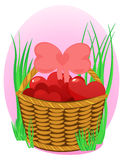 Wicker basket with hearts on pink background. Wicker basket topfull hearts on pink background with rich grass Royalty Free Stock Photo
