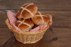 Wicker basket of hot cross buns Stock Images