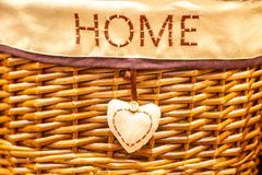 Wicker basket with the inscription house royalty free stock photography
