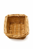 Wicker basket isolated on a white background. An empty wicker basket isolated on a white background Royalty Free Stock Photos