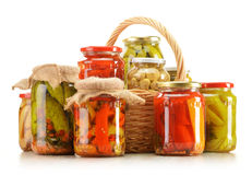 Wicker basket and jars of pickled vegetables Royalty Free Stock Photo