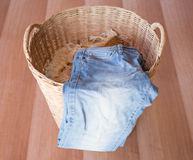 Wicker basket. Jeans in a wicker basket royalty free stock photography