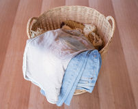 Wicker basket. Jeans in a wicker basket stock photography