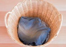 Wicker basket. Jeans in a wicker basket stock image