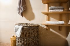 Wicker basket with laundry. In bathroom royalty free stock photo
