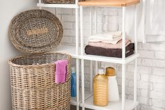 Wicker basket with laundry. In bathroom royalty free stock image