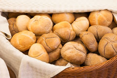 Wicker basket lined with a cloth filled with buns Royalty Free Stock Photo