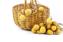 Wicker basket and longan Stock Photography