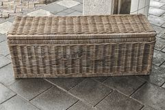 Wicker basket lying on the street royalty free stock photos