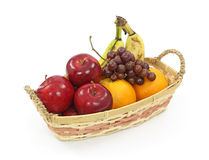 Wicker basket with mixed fruit Stock Photos