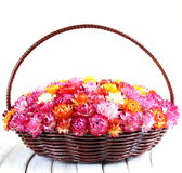 Wicker basket with multicolored flowers Stock Photography