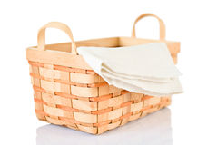 Wicker basket and napkin on white Royalty Free Stock Photography