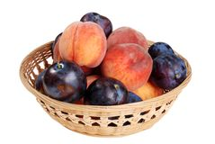 Wicker Basket Of Peaches And Plums Stock Image