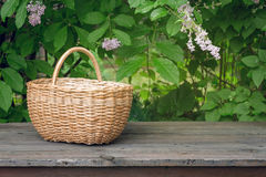Wicker basket on old wooden table Stock Photo