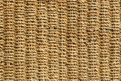 Wicker basket with original pattern. Straw background Royalty Free Stock Photography