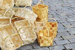 Wicker basket on the pavement Stock Photos