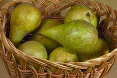 Wicker basket with pears Royalty Free Stock Photos