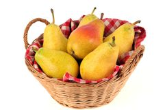 Wicker basket of pears on a white background royalty free stock image